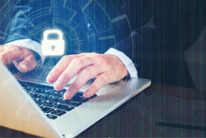 Businessman hand using laptop with Cyber security