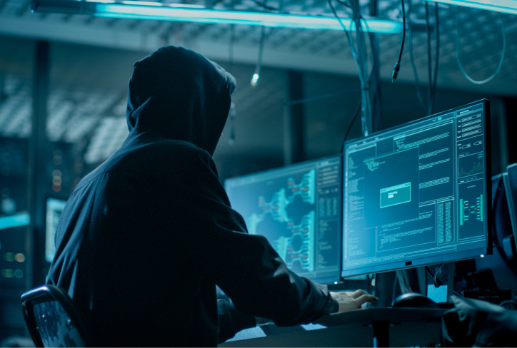 Hooded Hacker Breaking into Corporate Data Servers