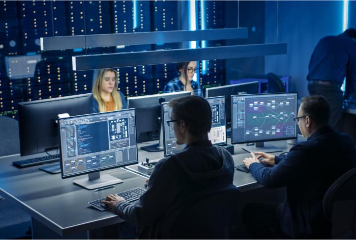 Team of IT Programers Working on Desktop-Computers in Data Center