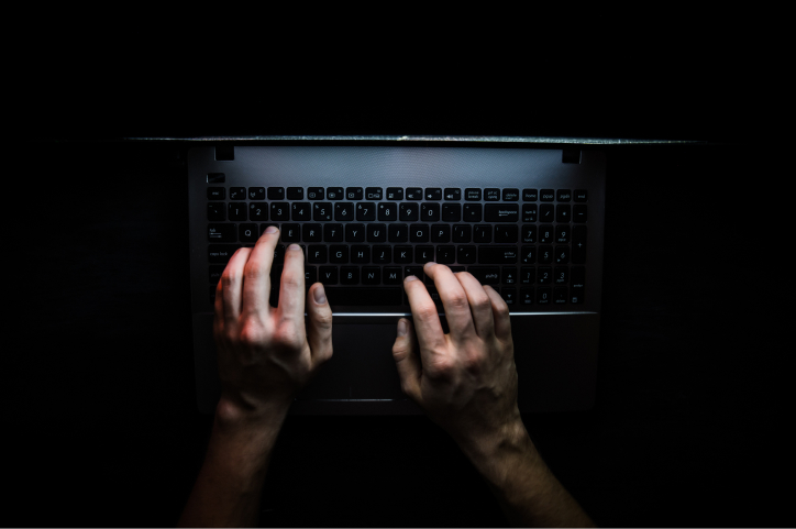 hacker hacking the server in the dark web